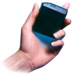 hand showing arbitron PPM device